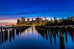 Sunset at Lower Manhattan Skyline, New York United States. Colorful sunset at Lower Manhattan Skyline view from Brooklyn Bridge Park, New York United States royalty free stock image