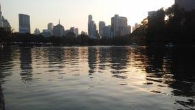 Sunset in Lumphini Park in Bangkok, Thailand. Royalty Free Stock Photo