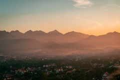 Sunset in Lunag Prabang, Laos. Beautiful clouds over the city. Mountains in the background. Amazing blue sky. Perfect condition. stock images
