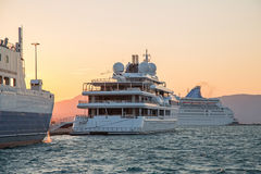 Sunset: Luxury large super or mega motor yacht in the evening. Royalty Free Stock Images