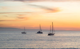 Sunset with luxury yacht. At sea Royalty Free Stock Photos