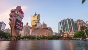 Sunset macau famous hotel lake panorama 4k time lapse china stock video