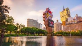 Sunset macau famous hotel pond panorama 4k time lapse china stock video