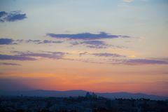 Sunset in Madrid with a sky of few clouds. Orange and blue. From where the Pirulí is see stock photo