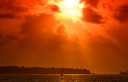 Sunset in the Maldives. Beautiful colorful sunset over the ocean in the Maldives seen from the beach Royalty Free Stock Image