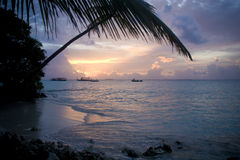 Sunset Maldives. Sunset in Maldivian sea, you may see in the silhouette a typical maldivian boat Stock Images