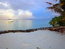 Sunset on Maldives. Splendid white yacht near beach on Maldives Stock Image