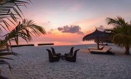 Sunset on a Maldivian beach Stock Images