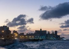 Sunset in the famous malecon in Havana, Cuba. Sunset at Malecon, the famous Havana promenades where Habaneros, lovers and most of all individual fishermen meet Royalty Free Stock Image