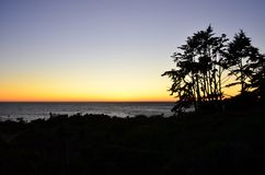 Sunset At Malibu Beach. You can see the tree and mountain silhouette royalty free stock image