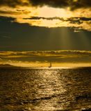Sunset Sunbeams over yacht royalty free stock photos