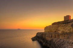 Sunset in Malta. A beautiful sunset over the island of Filfla just outside Malta in the Mediterranean Sea Royalty Free Stock Photos