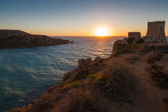 Sunset in Malta. Sunset over Gnejna Bay and Ghajn Tuffieha Tower, Malta Royalty Free Stock Photography
