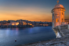 Sunset in Malta. Famous city ladnscape in Malta, in the old harbor Royalty Free Stock Image