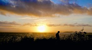 Sunset man silhouette Stock Photo