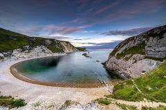 Sunset at Man of War Bay, Lulworth in Dorset England UK. Sunset at Man of War Bay, Lulworth in Dorset England United Kingdom Royalty Free Stock Photo