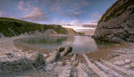 Sunset at Man of War Bay, Lulworth in Dorset England UK. Sunset at Man of War Bay, Lulworth in Dorset England United Kingdom Stock Photo