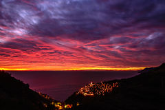 Sunset manarola cinque terre. Sunset over the ligurian sea in manarola in the unesco site cinque terre with nativity set Royalty Free Stock Image