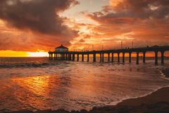 Sunset @ Manhattan Beach Pier in California. Another gorgeous orange and red sunset over the Pacific Ocean next to the Manhattan Beach Pier near Los Angeles stock images