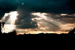 Sunset with many clouds and sun rays royalty free stock image
