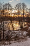 Sunset in March over the river. The ice on it almost melted Royalty Free Stock Images