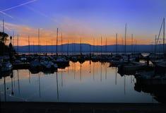 Sunset Marina. Summer sunset on a lake Geneva marina full of sailboats Royalty Free Stock Image