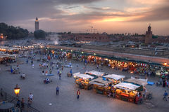 Sunset on marrakesh. Sunset on Djemaa El-fna place and koutoubia mosque, marrakesh, morocco Royalty Free Stock Photo