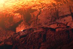 Sunset at the mars lightened the rocky surface. Of the planet. Heat burning terrain to the dust Royalty Free Stock Image