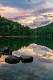 Sunset, Martins Fork Lake, Kentucky. A beautiful pastel sunset reflects in the still waters of Martins Fork lake in the Appalachian Mountains of Kentucky Stock Photo