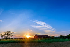 Sunset on a Maryland Farm. Sunset on a farm in Maryland with plowed field and red barn Stock Images