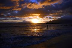 Sunset on Maui Island, Hawaii. Standing on the Beach in Kihei, Maui Island, Hawaii, this a view of a sunset Royalty Free Stock Photography