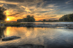 Sunset on the Maumee River. A beautiful Midwest Summer sunset on the Maumee River located in Grand Rapids, Ohio Stock Image