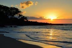 Sunset at Mauna Kea beach Big Island of Hawaii Stock Photos