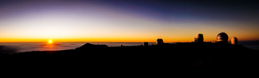 Sunset from Mauna Kea Hawaii. View from Mauna Kea, Big Island, Hawaii, USA at sunset on observatories and clouds of Hawaii Stock Images