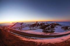 Sunset on Mauna Kea. Telescopes on the summit of Mauna Kea, Hawaii Royalty Free Stock Image