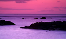 After Sunset in Mauritius. By a rocky beach Stock Image