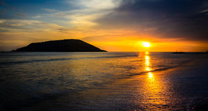 Sunset at Mazatlan beach, Mexico. Beautiful sunset at Mazatlan beach, Mexico. You can see and island and the sun reflected on the sea Royalty Free Stock Photos