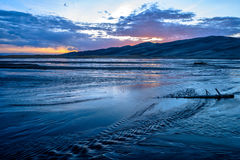 Sunset at Medano Creek. Spring sunset view of Medano Creek at the base of great sand dunes. Great Sand Dunes National Park & Preserve, Colorado, USA Royalty Free Stock Photo