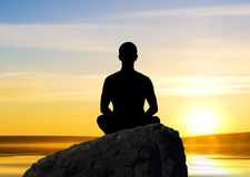 Sunset meditation Stock Images