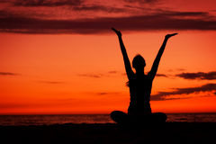 Sunset meditation. Stock Photos