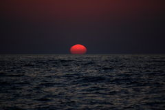 Sunset in mediteranian sea. Strange sun shape at the sunset Royalty Free Stock Images