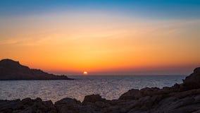 Sunset at mediterranean beach. Mediterranean beach at sunset with orange sky Royalty Free Stock Images