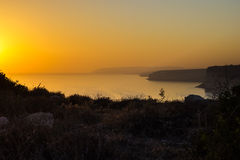 Sunset on the Mediterranean Coast  Overlooking the Dliffs and th Royalty Free Stock Photos