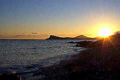 Sunset. On the Mediterranean island beach royalty free stock images