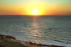 Sunset by the Mediterranean sea. And its color reflection. Tel-Aviv. Israel royalty free stock photography