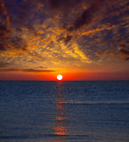 Sunset at Mediterranean sea with orange sky Royalty Free Stock Image