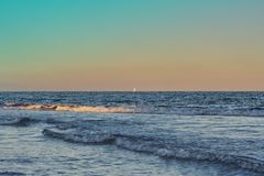 Sunset in the Mediterranean Sea with sailboats in the background royalty free stock photos