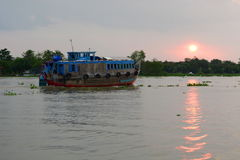 Sunset in Mekong delta. Cai Be. Vietnam Stock Photo