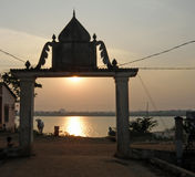 Sunset on the Mekong river. Sunset through an arch on the banks of the Mekong river in Cambodia Stock Photos