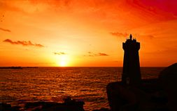 Sunset at Men ruz lighthouse at Pink Granite coast in Brittany. Sunset at Phare de Men Ruz. Côte de Granit Rose is one of the most beautiful stretches of royalty free stock images